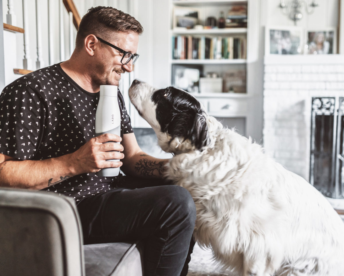 Tim Landis with dog and White/Pebble LARQ Bottle Movement Terra Edition